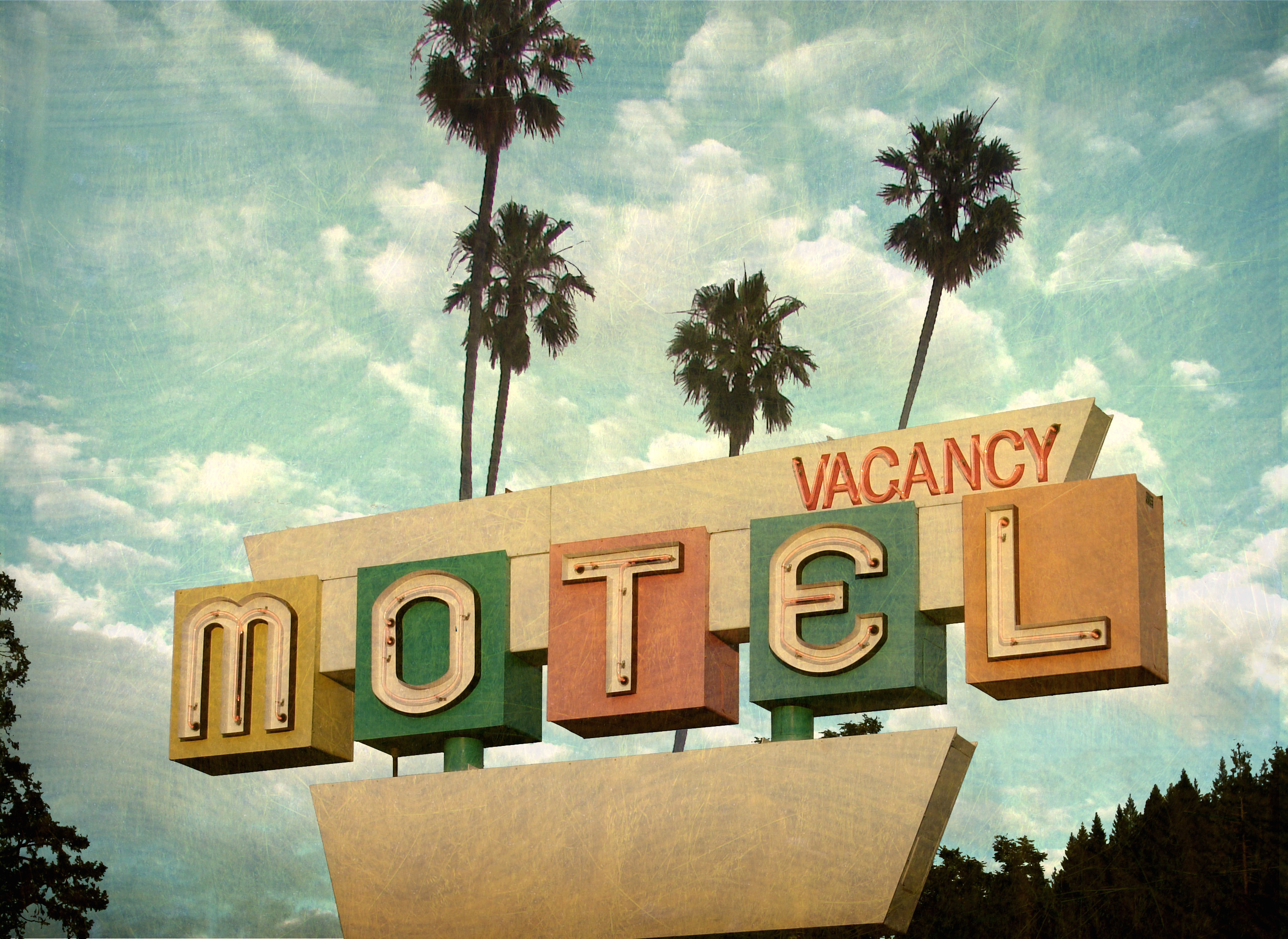 Ged And Worn Vintage Photo Of Retro Motel Sign With Palm