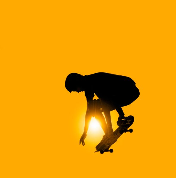 Skateboarder Jumping His Skateboard Stick On Wallpaper