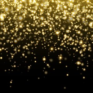 Gold Star dust on a black background