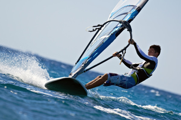 Side view of young windsurfer
