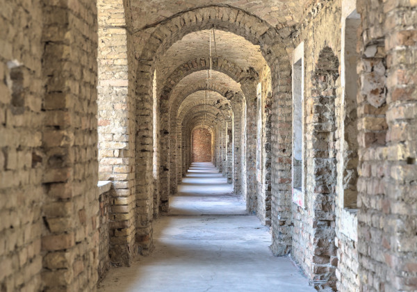 Castle tunnel with a series of arches in the ruined Bastion fortress in the Slovak city of Komarno.