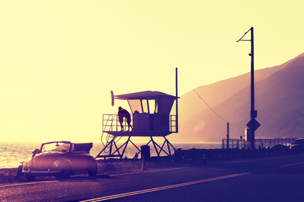 Vintage filtered sunset over beach with lifeguard tower, Pacific