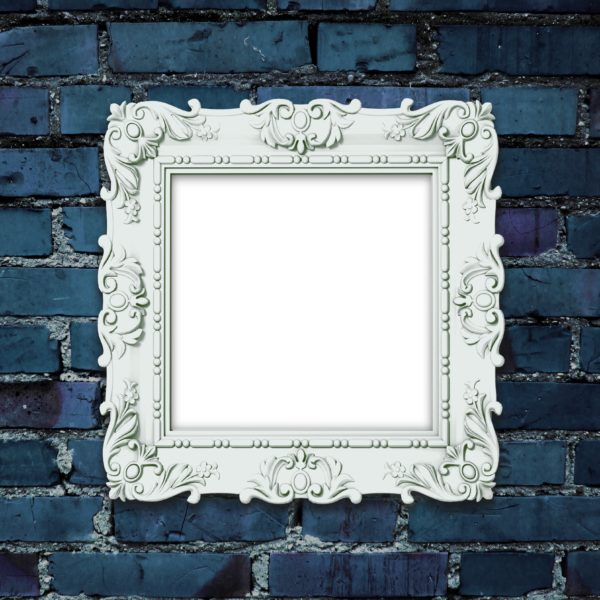 Close-up of one decorated picture frame on dark blue brick wall background