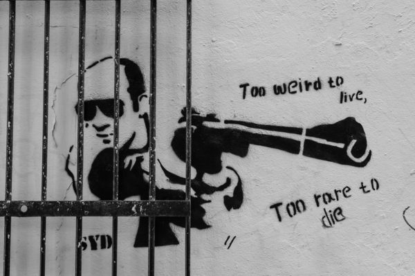 Man with gun – Street art in London